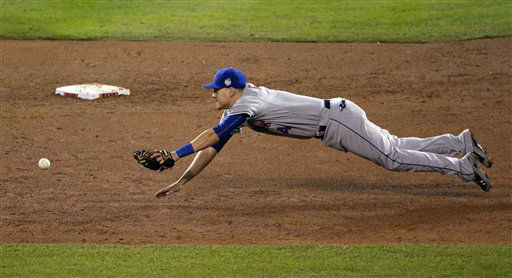 "<div class=""meta image-caption""><div class=""origin-logo origin-image none""><span>none</span></div><span class=""caption-text"">Mets shortstop Wilmer Flores dives for a Kansas City Royals' Eric Hosmer two-RBI single during the fifth inning. (AP Photo/Charlie Riedel)  (AP Photo/ Charlie Riedel)</span></div>"