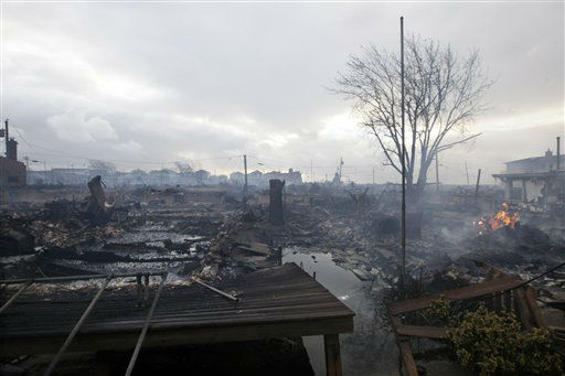 "<div class=""meta image-caption""><div class=""origin-logo origin-image none""><span>none</span></div><span class=""caption-text"">Damage caused by a fire at Breezy Point is shown Tuesday, Oct. 30, 2012, in in the New York City borough of Queen. (AP Photo/ Frank Franklin II)</span></div>"