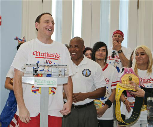 "<div class=""meta image-caption""><div class=""origin-logo origin-image none""><span>none</span></div><span class=""caption-text"">Brooklyn Borough President Eric Adams watches as Joey Chestnut, left, weighs in during a news conference.  (AP Photo/ Frank Franklin II)</span></div>"