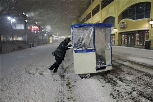 <div class='meta'><div class='origin-logo' data-origin='none'></div><span class='caption-text' data-credit='AP Photo/ Mel Evans'>A man maneuvers his Push cart with passengers during a snowstorm early Saturday, Jan. 23, 2016, on the Atlantic City Boardwalk.</span></div>