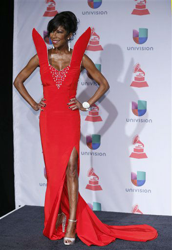 "<div class=""meta image-caption""><div class=""origin-logo origin-image none""><span>none</span></div><span class=""caption-text"">Natalie Cole arrives at the 14th Annual Latin Grammy Awards in Las Vegas in 2013. (Photo by Eric Jamison/Invision/AP) (Photo/Eric Jamison)</span></div>"
