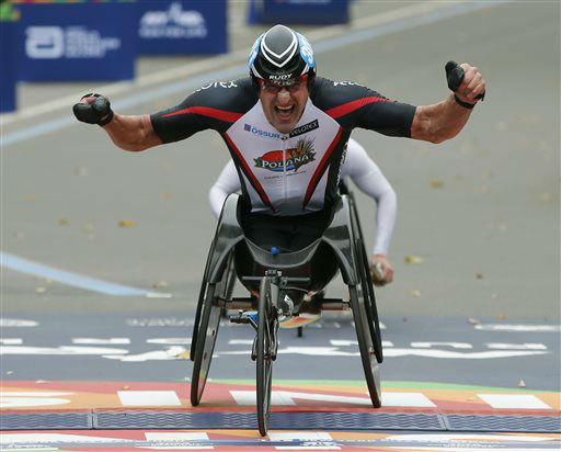 <div class='meta'><div class='origin-logo' data-origin='none'></div><span class='caption-text' data-credit='AP Photo/ Kathy Willens'>Ernst Van Dyck, of South Africa, celebrates after winning the men's wheelchair division.</span></div>