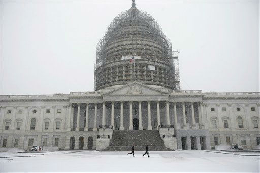 <div class='meta'><div class='origin-logo' data-origin='none'></div><span class='caption-text' data-credit='AP Photo/ Alex Brandon'>Two runners jog as the snow falls on Capitol Hill, Friday, Jan. 22,</span></div>