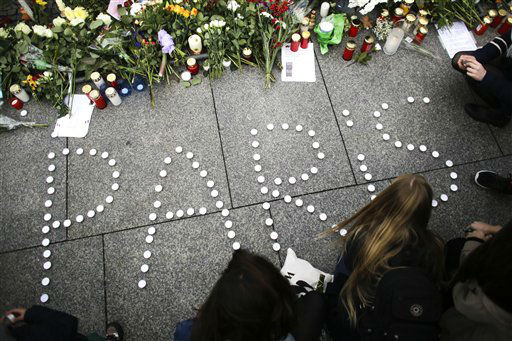 """<div class=""""meta image-caption""""><div class=""""origin-logo origin-image none""""><span>none</span></div><span class=""""caption-text"""">Young women have formed  the word Paris with candles to mourn for the victims killed in  Friday's attacks in Paris, France. (AP Photo/ Markus Schreiber)</span></div>"""