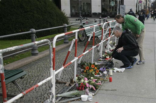 """<div class=""""meta image-caption""""><div class=""""origin-logo origin-image none""""><span>none</span></div><span class=""""caption-text"""">Two men lay down flowers to mourn for the victims killed in the Friday's attacks in Paris, France, in front of the French Embassy in Berlin, Saturday, Nov. 14, 2015. (AP Photo/ Markus Schreiber)</span></div>"""