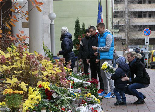 """<div class=""""meta image-caption""""><div class=""""origin-logo origin-image none""""><span>none</span></div><span class=""""caption-text"""">People lay flowers in front of the French Embassy in Kiev, Ukraine, Saturday, Nov. 14, 2015, to mourn the victims in Friday's Paris attacks.  (AP Photo/ Sergei Chuzavkov)</span></div>"""