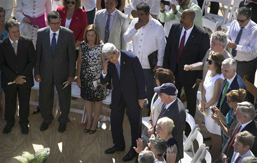 "<div class=""meta image-caption""><div class=""origin-logo origin-image none""><span>none</span></div><span class=""caption-text"">U.S. Secretary of State John Kerry, center, attends the flag raising ceremony at the newly opened U.S. Embassy. (AP Photo/Ramon Espinosa) (AP Photo/ Ramon Espinosa)</span></div>"