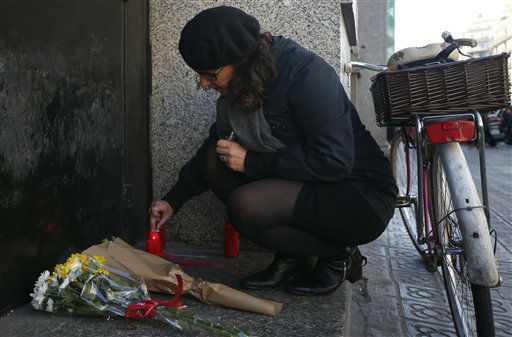 """<div class=""""meta image-caption""""><div class=""""origin-logo origin-image none""""><span>none</span></div><span class=""""caption-text"""">A woman lights a candle outside the French consulate in Barcelona, Spain, Saturday Nov. 14, 2015, for the victims in Friday's Paris attacks.  (AP Photo/ Manu Fernandez)</span></div>"""