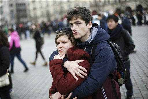 """<div class=""""meta image-caption""""><div class=""""origin-logo origin-image none""""><span>none</span></div><span class=""""caption-text"""">A young couple mourns for the victims killed in the Friday's attacks in Paris, France, in front of the French Embassy in Berlin, Saturday, Nov. 14, 2015.  (AP Photo/ Markus Schreiber)</span></div>"""