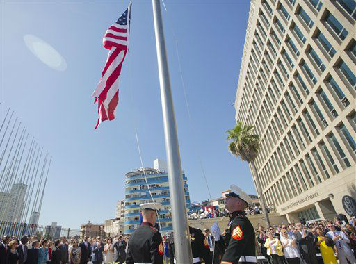 "<div class=""meta image-caption""><div class=""origin-logo origin-image none""><span>none</span></div><span class=""caption-text"">U.S. Marines raise the U.S. flag over the newly reopened embassy in Havana, Cuba. Friday, Aug. 14, 2015. (AP Photo/Pablo Martinez Monsivais,Pool) (AP Photo/ Pablo Martinez Monsivais)</span></div>"