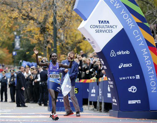 <div class='meta'><div class='origin-logo' data-origin='none'></div><span class='caption-text' data-credit='AP Photo/ Kathy Willens'>Mary Keitany of Kenya reacts as she crosses the finish line to win the professional women's athlete division.</span></div>