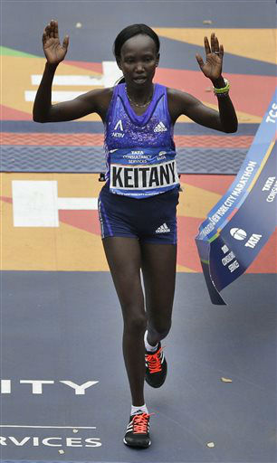 <div class='meta'><div class='origin-logo' data-origin='none'></div><span class='caption-text' data-credit='AP Photo/ Seth Wenig'>Mary Keitany, of Kenya, crosses the finish line first in the women's division at the 2015 New York City Marathon in New York, Sunday, Nov. 1, 2015.</span></div>