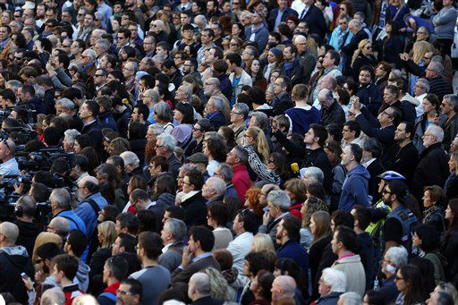 """<div class=""""meta image-caption""""><div class=""""origin-logo origin-image none""""><span>none</span></div><span class=""""caption-text"""">People observe a minute of silence for the victims killed in the Friday's attacks in Paris at the Sant Jaume square in Barcelona, Spain, Saturday, Nov. 14, 2015. (AP Photo/ Manu Fernandez)</span></div>"""