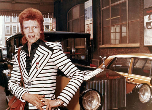 <div class='meta'><div class='origin-logo' data-origin='none'></div><span class='caption-text' data-credit='AP Photo/ XCJ AD'>British rock singer, David Bowie, poses beside his Rolls Royce in May 1973. (AP Photo)</span></div>