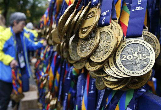 <div class='meta'><div class='origin-logo' data-origin='none'></div><span class='caption-text' data-credit='AP Photo/ Kathy Willens'>A volunteer unpacks medals for runners who complete the New York City marathon at the marathon finish line in New York, Sunday, Nov. 1, 2015.</span></div>