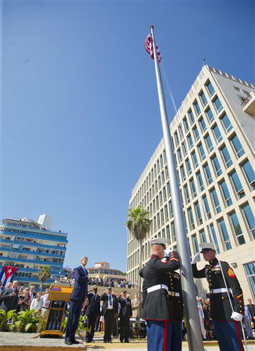"<div class=""meta image-caption""><div class=""origin-logo origin-image none""><span>none</span></div><span class=""caption-text"">Secretary of State John Kerry, left, and other dignitaries watch the raising of the U.S. flag over the newly reopened embassy in Havana. (AP Photo/Pablo Martinez Monsivais,Pool) (AP Photo/ Pablo Martinez Monsivais)</span></div>"
