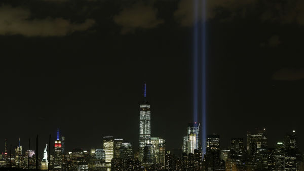 "<div class=""meta image-caption""><div class=""origin-logo origin-image none""><span>none</span></div><span class=""caption-text"">The Tribute in Light rises above the New York skyline Friday, Sept. 11,  2015, in a view from Bayonne, N.J.  (AP Photo/ Mark Lennihan)</span></div>"