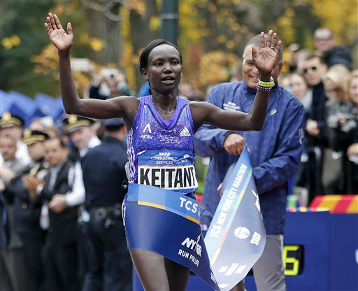 <div class='meta'><div class='origin-logo' data-origin='none'></div><span class='caption-text' data-credit='AP Photo/ Kathy Willens'>Mary Keitany of Kenya reacts as she crosses the finish line, winning the professional women's athlete division.</span></div>