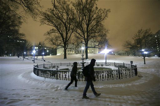 <div class='meta'><div class='origin-logo' data-origin='none'></div><span class='caption-text' data-credit='AP Photo/ Steve Helber'>A couple walks past the fountain on the snow covered grounds of the State Capitol in Richmond, Va., Friday, Jan. 22, 2016.</span></div>