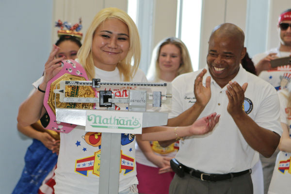 "<div class=""meta image-caption""><div class=""origin-logo origin-image none""><span>none</span></div><span class=""caption-text"">Brooklyn Borough President Eric Adams, claps for Miki Sudo, left, during a news conference.  (AP Photo/ Frank Franklin II)</span></div>"