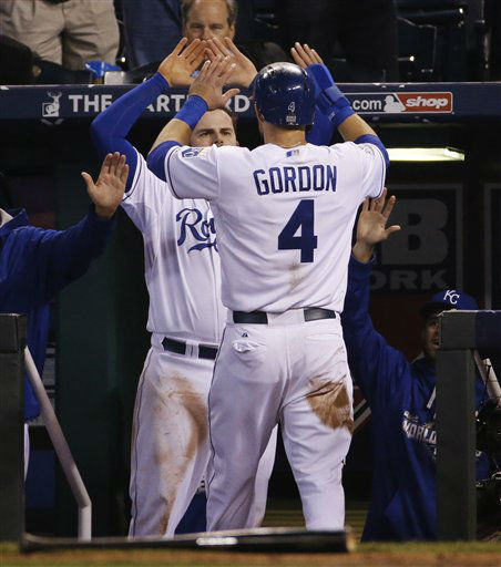 "<div class=""meta image-caption""><div class=""origin-logo origin-image none""><span>none</span></div><span class=""caption-text"">Kansas City Royals' Alex Gordon (4) is congratulated by a teammate after scoring on an RBI single by Alcides Escobar during the fifth inning. (AP Photo/ Matt Slocum)</span></div>"