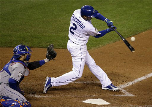 "<div class=""meta image-caption""><div class=""origin-logo origin-image none""><span>none</span></div><span class=""caption-text"">Kansas City Royals' Alcides Escobar hits an RBI single during the fifth inning of Game 2. (AP Photo/ David Goldman)</span></div>"