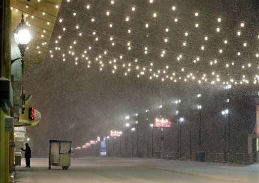 <div class='meta'><div class='origin-logo' data-origin='none'></div><span class='caption-text' data-credit='AP Photo/ Mel Evans'>A stands near his Push cart during a snowstorm early Saturday, Jan. 23, 2016, on the Atlantic City Boardwalk.</span></div>