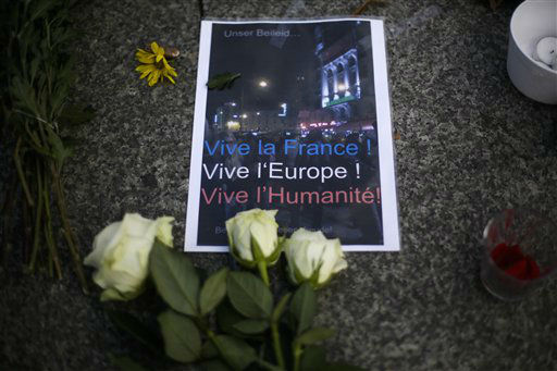 """<div class=""""meta image-caption""""><div class=""""origin-logo origin-image none""""><span>none</span></div><span class=""""caption-text"""">A poster and flowers to mourn for the victims killed in the Friday's attacks in Paris, France, sit in front of the French Embassy  in Berlin, Saturday, Nov. 14, 2015.  (AP Photo/ Markus Schreiber)</span></div>"""