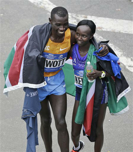 <div class='meta'><div class='origin-logo' data-origin='none'></div><span class='caption-text' data-credit='AP Photo/ Seth Wenig'>New York City Marathon winners Stanley Biwott, left, and Mary together after finishing , both from Kenya, hug at the finish line.</span></div>