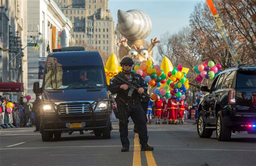 <div class='meta'><div class='origin-logo' data-origin='none'></div><span class='caption-text' data-credit='AP Photo/ Bryan R. Smith'>An armed police officer stands guard at the start of the Macy's Thanksgiving Day Parade, Thursday Nov. 26, 2015, in New York.  (AP Photo/Bryan R. Smith)</span></div>