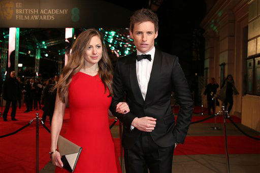 "<div class=""meta image-caption""><div class=""origin-logo origin-image none""><span>none</span></div><span class=""caption-text"">Hannah Bagshawe and Eddie Redmayne pose for photographers upon arrival.  (Jonathan Short )</span></div>"