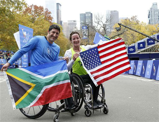 <div class='meta'><div class='origin-logo' data-origin='none'></div><span class='caption-text' data-credit='AP Photo/ Kathy Willens'>Ernst Van Dyk, of South Africa, left, and Tatyana McFadden, of the United States, pose after taking first place in the mens and women's wheelchair division.</span></div>