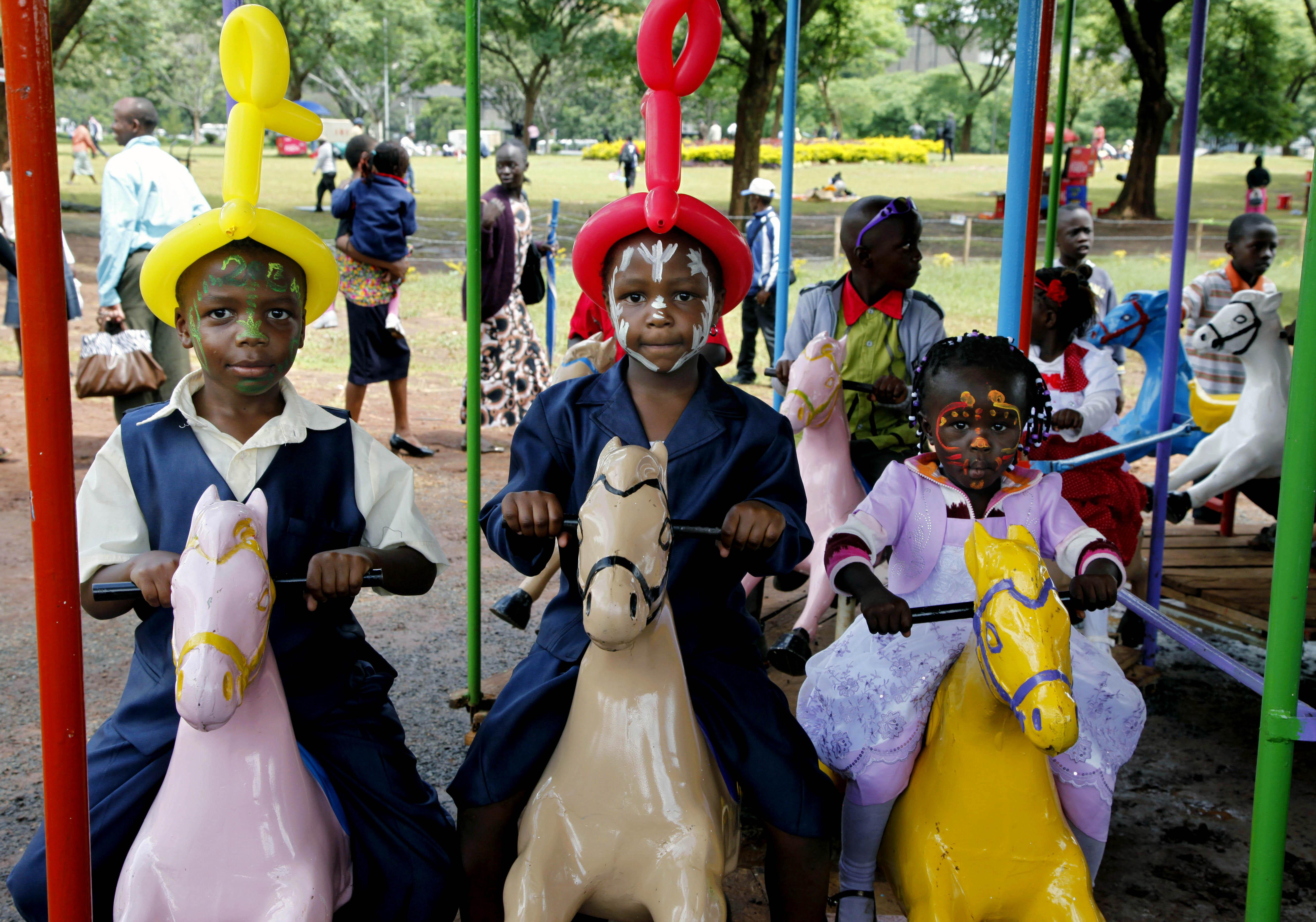 "<div class=""meta image-caption""><div class=""origin-logo origin-image none""><span>none</span></div><span class=""caption-text"">Kenyan children ride a carousel as families gather to celebrate the new year at Uhuru Park, Nairobi, Kenya. (AP)</span></div>"