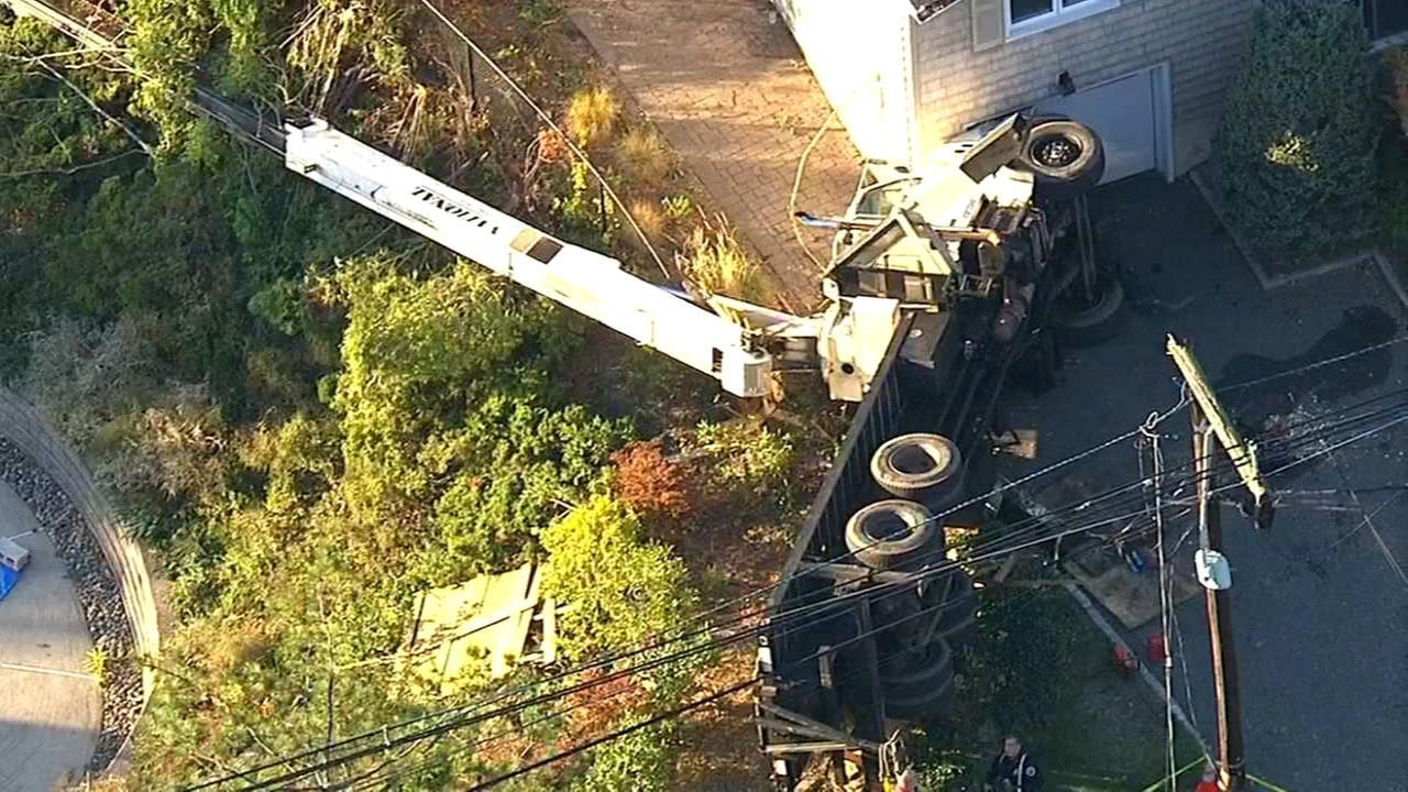 Large crane truck overturns in New Jersey neighborhood