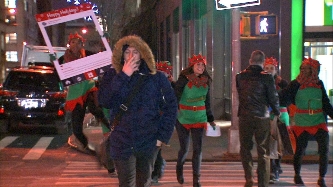 Elves help pedestrians cross street safely near Holland Tunnel
