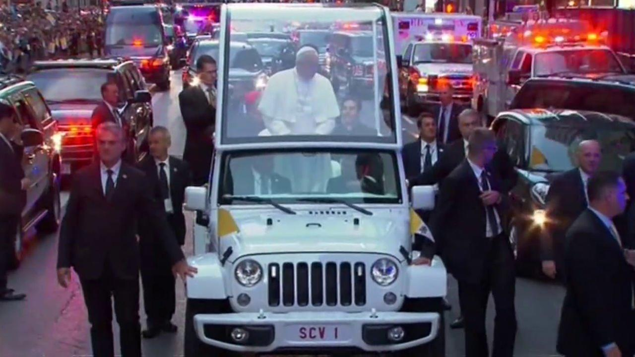 Pope Francis popemobile makes its way through the streets of Midtown Manhattan on Thursday, Sept. 24, 2015.
