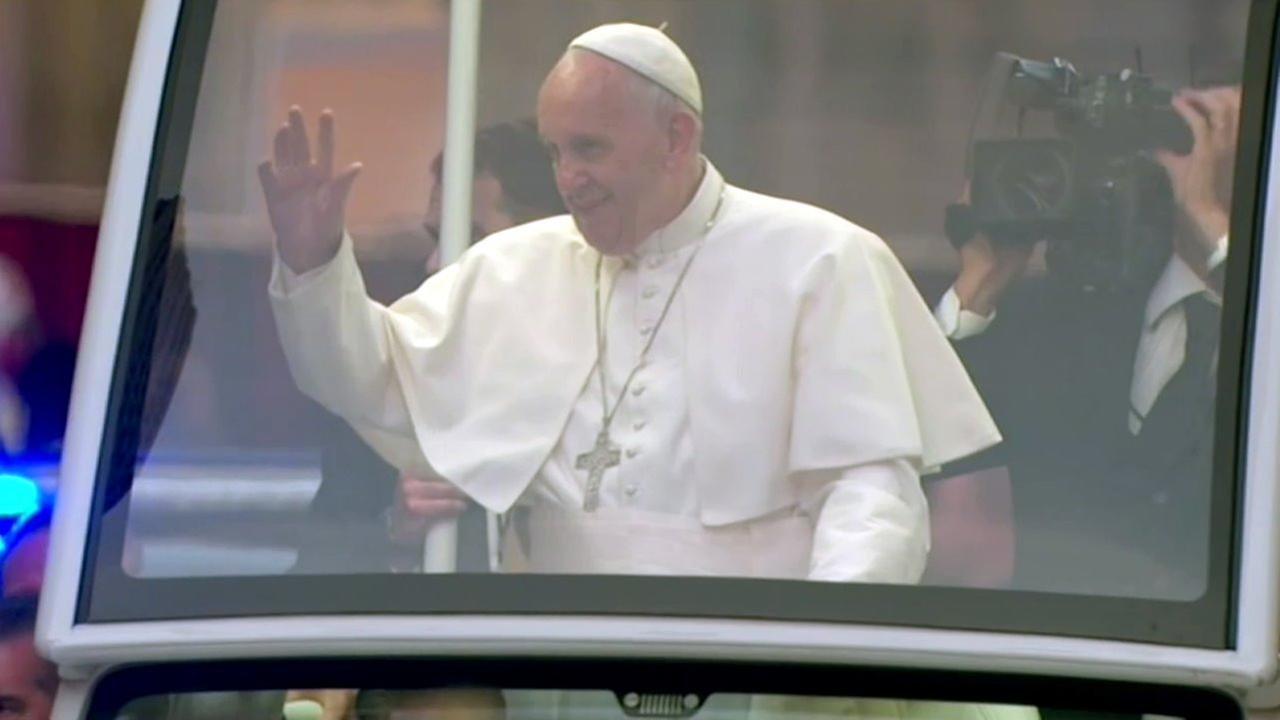 Pope Francis smiles as he waves at the crowd lining Fifth Avenue in New York City on Thursday, Sept. 24, 2015.