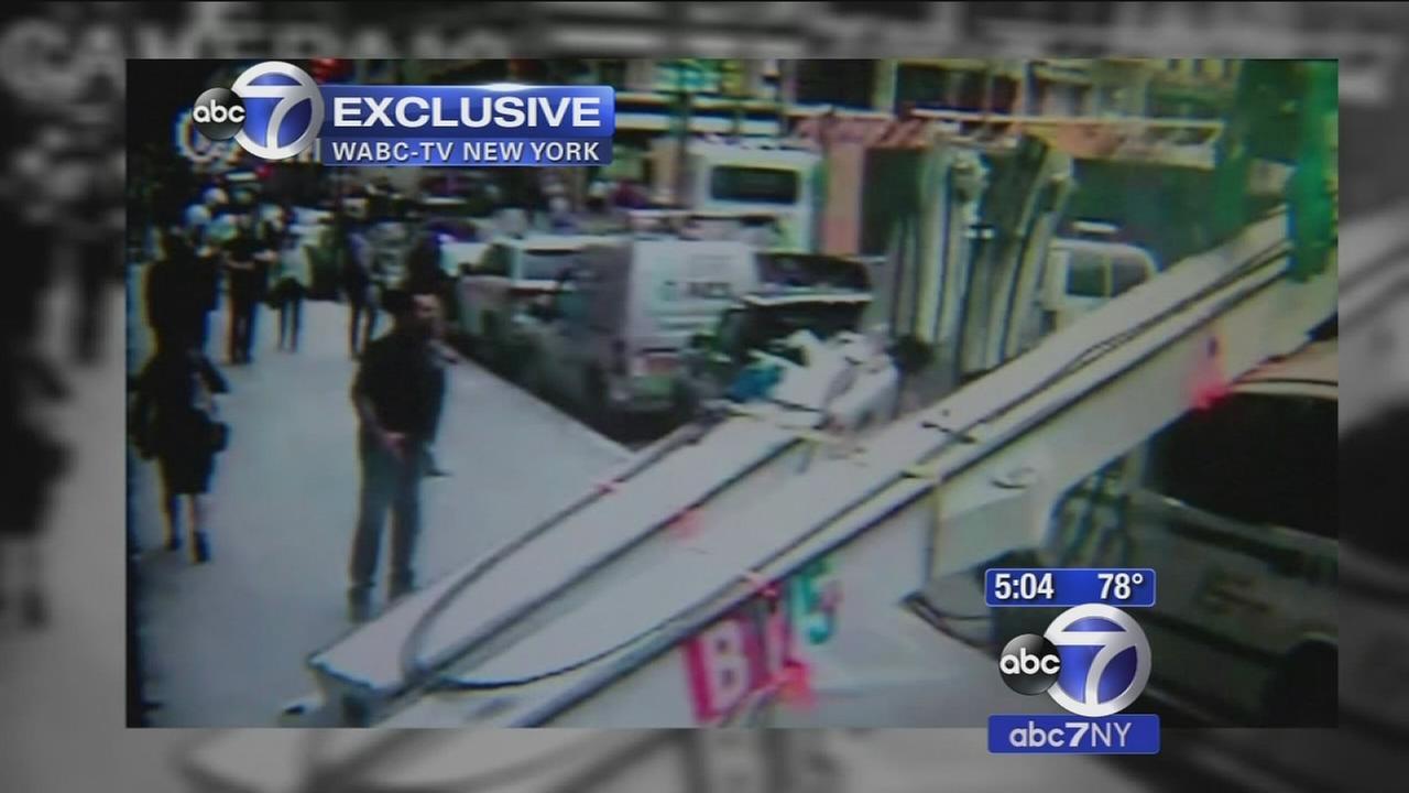 Video shows Midtown construction boom crashing down on NYPD van
