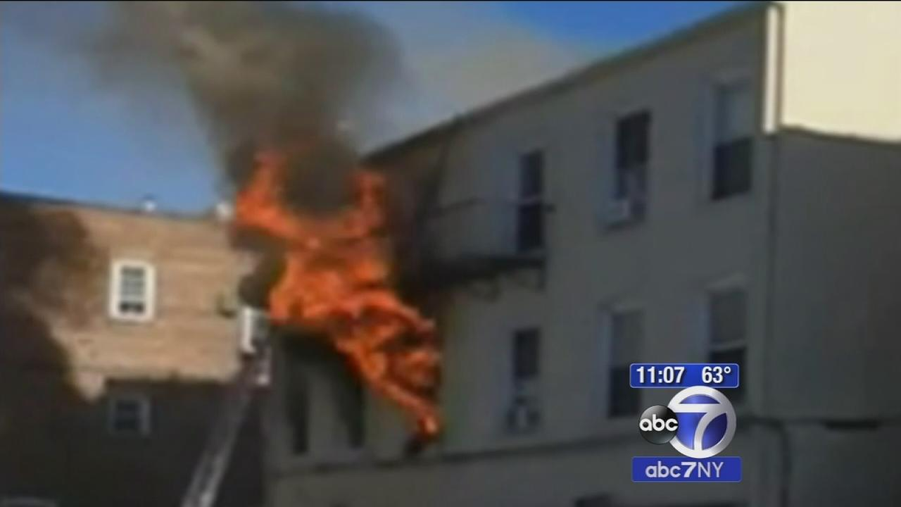 Officers save man from burning building