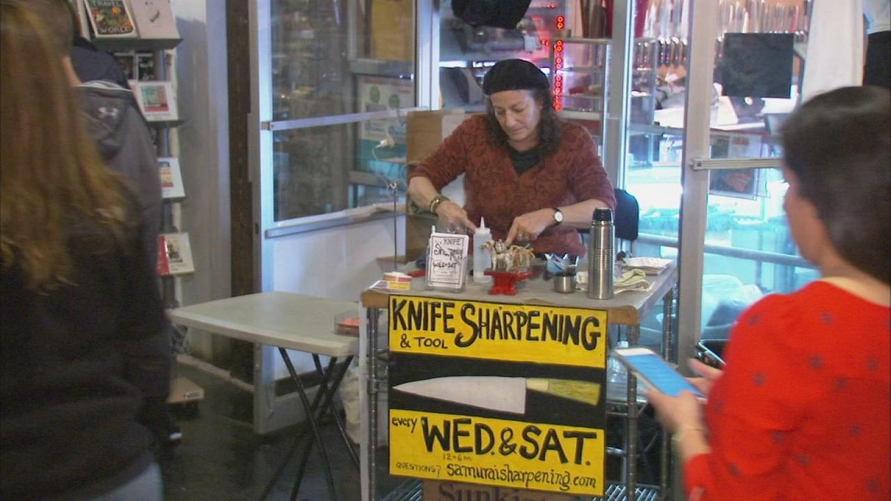 Knife-sharpening lady in Chelsea Market