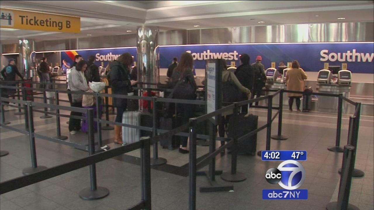 Travelers set out on holiday getaway