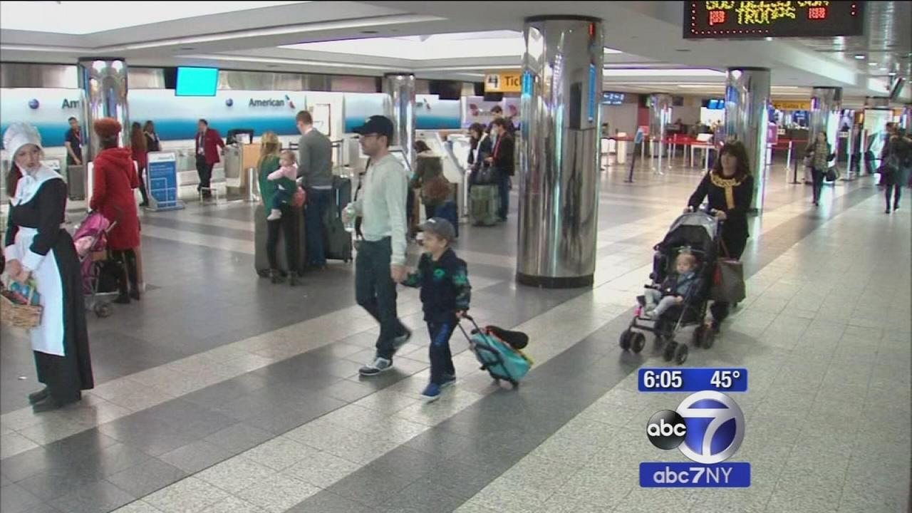 Travelers head out to holiday destinations