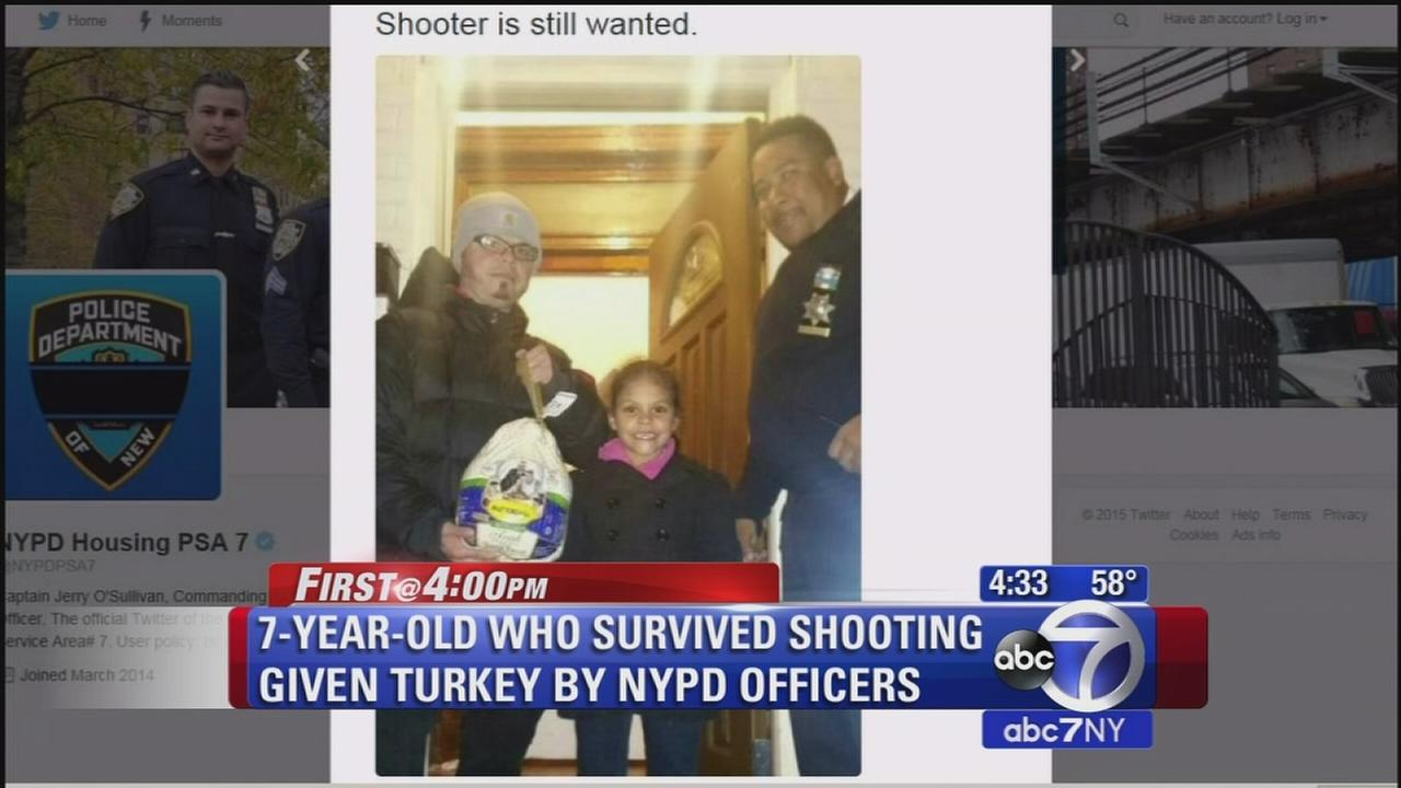 112615-wabc-4pm-girl-gets-turkey-nypd-vid