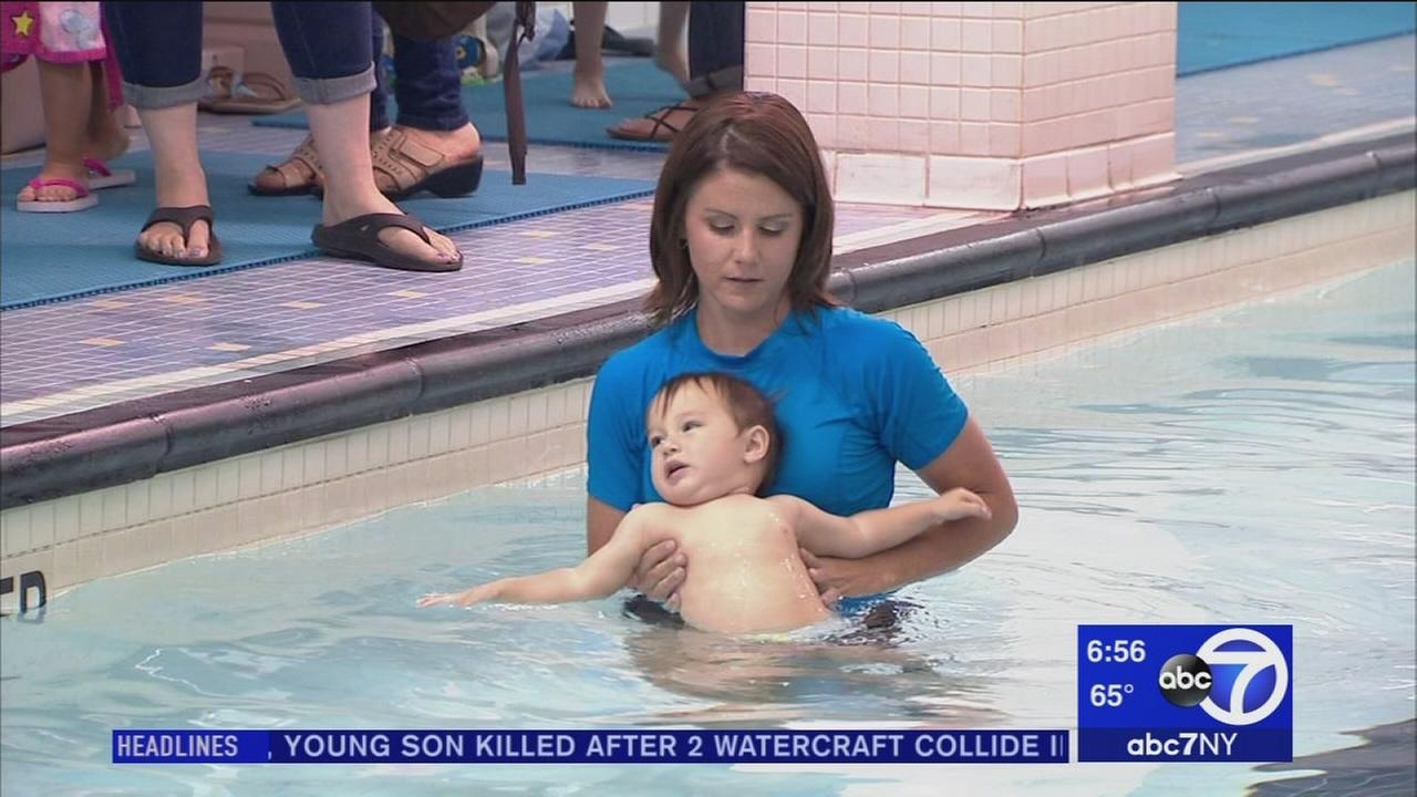 Babies learn to fend for themselves in swim classes