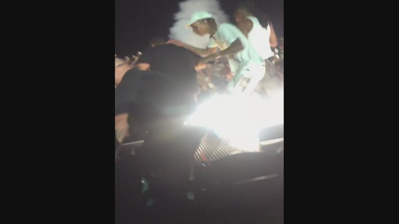 Railing collapses at a Snoop Dogg and Wiz Khalifa concert