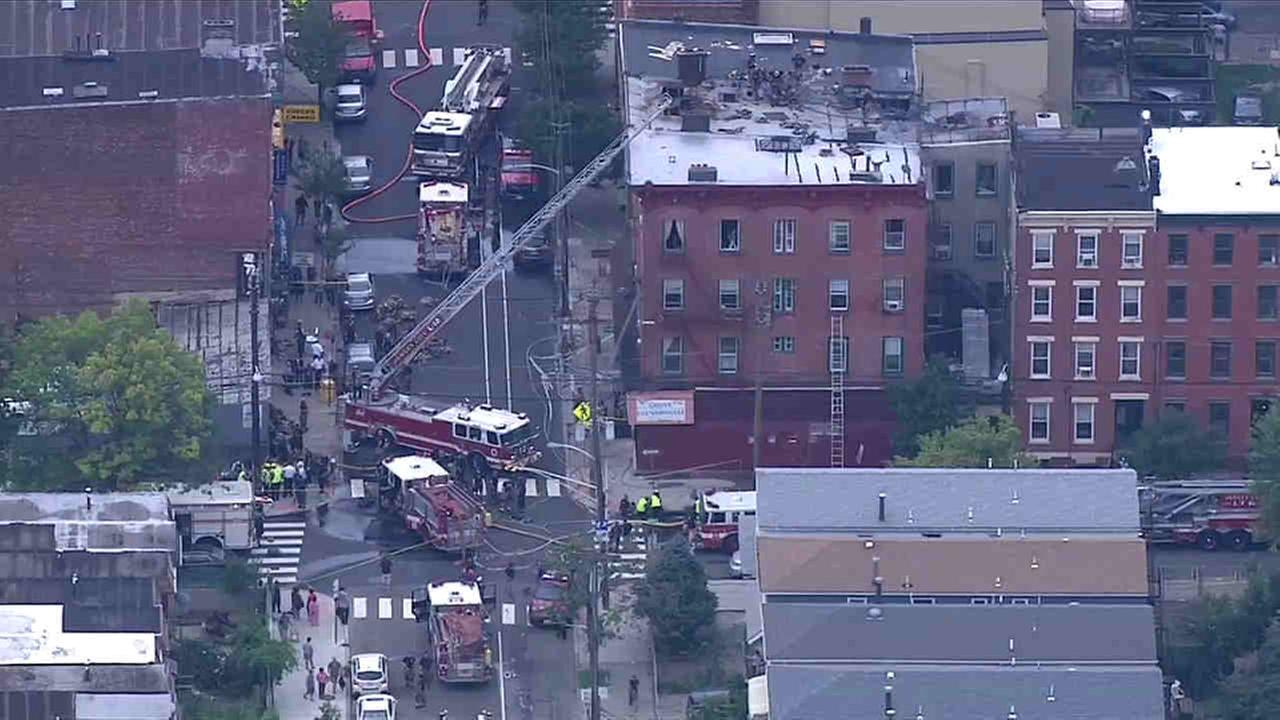 Several firefighters were overwhelmed by the heat in Jersey City.