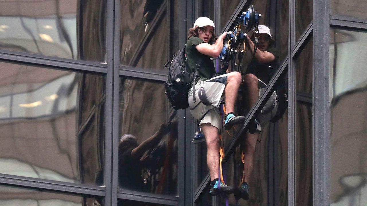 A man scales the all-glass facade of Trump Tower using suction cups Wednesday, Aug. 10, 2016, in New York.AP Photo/Julie Jacobson