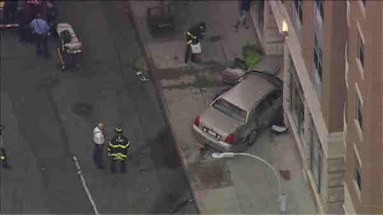 After a multi-car collision in Harlem, a car crashed into a building.