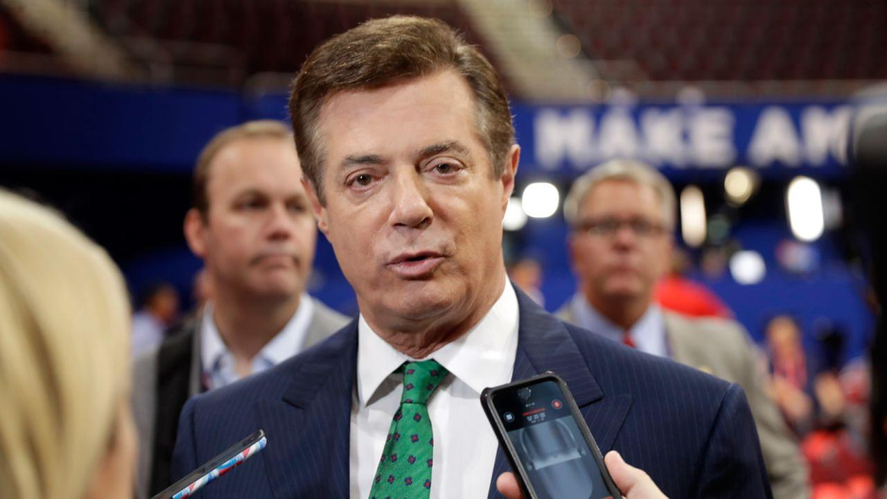Trump Campaign Chairman Paul Manafort talks to reporters on the floor of the Republican National Convention at Quicken Loans Arena, in Cleveland.