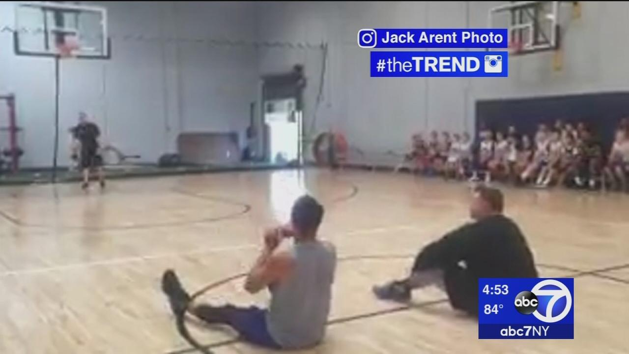 The Trend: Drake makes incredible half-court shot while lying down
